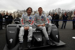 Jacques Villeneuve and Sébastien Bourdais pose with the Peugeot 908 HDi FAP