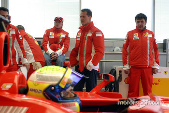 Kimi Raikkonen and Michael Schumacher look on