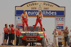 Car category podium: Stéphane Peterhansel and Jean-Paul Cottret celebrate