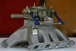The manifold and carburetor of the NAPA Toyota at tech inspection