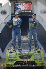 Podium: winners Mikko Hirvonen and Jarmo Lehtinen