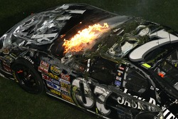 Last lap crash: the car of Clint Bowyer on fire and filled with grass