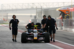 Mark Webber stops at the entrance of the pitlane