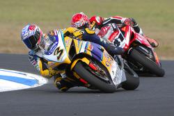 Max Biaggi leads Noriyuki Haga in the first race