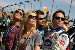Vanessa Minnillo, Chandra Johnson, Nick Lachey and Jimmie Johnson watch the pre-race festivities