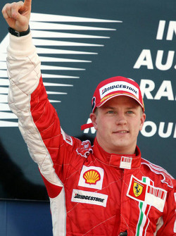 Podium: winner Kimi Raikkonen celebrates