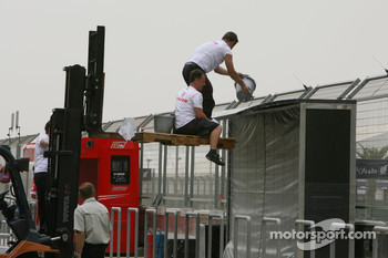 McLaren Mercedes personnel clean their pit gantry