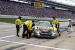 Bobby Labonte's crew work on the wheel alignment