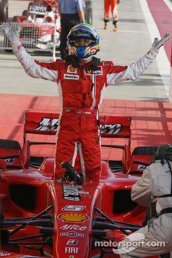 Race winner Felipe Massa celeberates