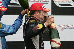 Podium: champagne shower for Robert Doornbos