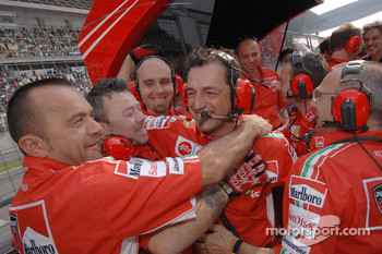 Ducati Marlboro team members celebrate victory