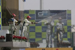 Timo Glock celebrates on the podium with Javier Villa  and Lucas di Grassi