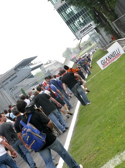 Fans walk to the podium after the race