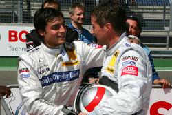Bernd Schneider, Team HWA AMG Mercedes, congratulates Bruno Spengler, Team HWA AMG Mercedes, with his pole position