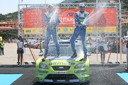 Podium: rally winners Marcus Gronholm and Timo Rautianen celebrate