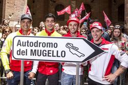 Yonny Hernandez and Danilo Petrucci, Pramac Racing Ducatis and Andrea Iannonen and Andrea Dovizioso, Ducati Team in Piazza del Campo, Siena