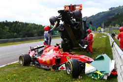 Marshals remove the start crash involving Fernando Alonso, McLaren MP4-30 and Kimi Raikkonen, Ferrari SF15-T