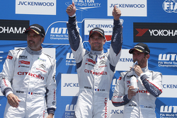 Podium: winner Sébastien Loeb, second place Yvan Muller, third place Jose Maria Lopez