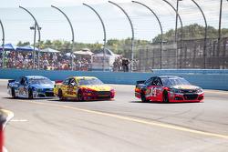Tony Stewart, Stewart-Haas Racing Chevrolet and Joey Logano, Team Penske Ford and Dale Earnhardt Jr., Hendrick Motorsports Chevrolet