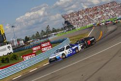 David Ragan, Michael Waltrip Racing Toyota and Martin Truex Jr., Furniture Row Racing Chevrolet