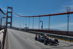 James Hinchcliffe drives the Astor Cup across the Golden Gate Bridge