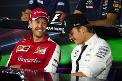 Sebastian Vettel, Ferrari and Nico Rosberg, Mercedes AMG F1 in the FIA Press Conference