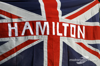 A flag for Lewis Hamilton, McLaren Mercedes
