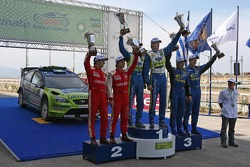 Podium: winners Marcus Gronholm and Timo Rautiainen, second place Sébastien Loeb and Daniel Elena, third place Petter Solberg and Phil Mills
