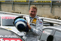 Pole winner Mika Häkkinen celebrates