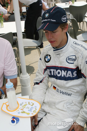 Sebastian Vettel, Test Driver, BMW Sauber F1 Team, is presented a bib saying