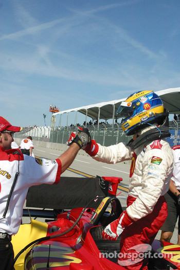 Sébastien Bourdais accepts congratulations from his team after winning the provisional pole