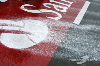The rain takes the paint of the signage in the pitlane