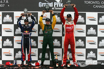 Podium: race winner Will Power with Neel Jani and Justin Wilson