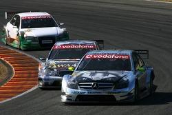 Bernd Schneider, Team HWA AMG Mercedes, AMG Mercedes C-Klasse, leads Paul di Resta, Persson Motorsport AMG Mercedes, AMG Mercedes C-Klasse and Marcus Winkelhock, TME, Audi A4 DTM