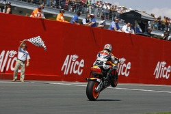 Dani Pedrosa takes the checkered flag