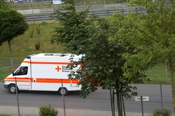 Lewis Hamilton, McLaren Mercedes, is driven away in an ambulance after crashing heavily