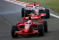 Felipe Massa, Scuderia Ferrari, F2007 and Fernando Alonso, McLaren Mercedes, MP4-22