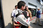 Fastest man of the day Patrick Carpentier celebrates with wife Anick