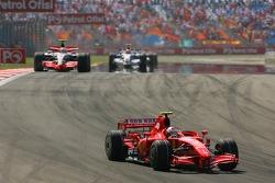 Kimi Raikkonen, Scuderia Ferrari, F2007 leads Lewis Hamilton, McLaren Mercedes, MP4-22