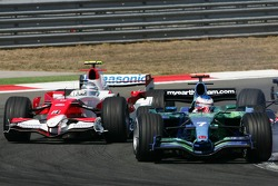 Jenson Button, Honda Racing F1 Team, RA107 and Jarno Trulli, Toyota Racing, TF107