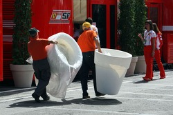 Workers bring items in the paddock
