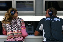 Girl talking with a Red Bull Racing mechanic