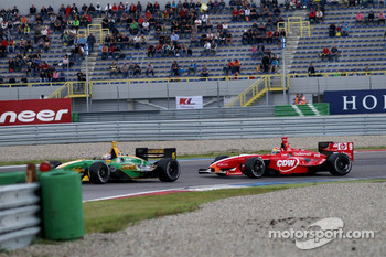 Justin Wilson, in a tight battle with Will Power