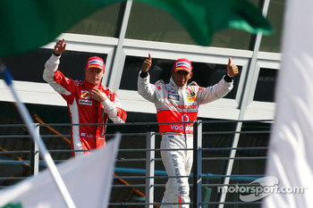 Podium: Kimi Raikkonen and Lewis Hamilton