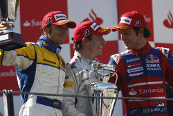 Timo Glock celebrates victory on the podium with Luca Filippi and Bruno Senna