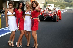 Martini Girls in the pitlane as Scuderia Ferrari team members take a rear view