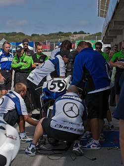 Jake Holden's crew feverishly work on Holden's bike durig a red flag delay in Sunday's Superstock Race