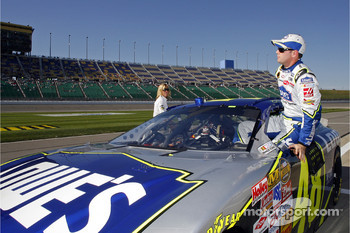 Pole sitter Jimmie Johnson climbs from his car after posting the top qualifying speed