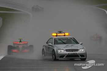 Lewis Hamilton, McLaren Mercedes, MP4-22 behind the safety car