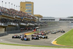 Timo Glock leads the field into turn one on the opening lap of the race